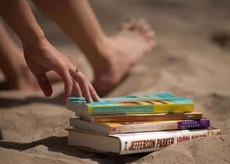 Image of books on a beach