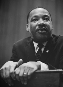 Image of Dr. Martin Luther King leaning on a lectern. The Nobel Foundation (Public Domain)