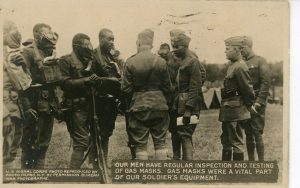"Photo of African American soldiers wearing gas masks. Photo credit: U. S. Signal Corps, ""Our men have regular inspection and testing of gas masks,"" circa 1917. African American Real Photo Postcard Collection."