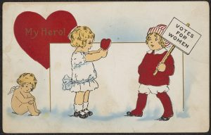 """Valentine showing girl holding out heart to boy holding """"Votes for Women"""" picket sign with the text """"My Hero!"""""""