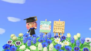 Screen capture of Animal Crossing avatar beside two paintings of Eisenhower and Peabody Library