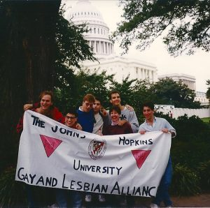 Students in Washington D.C. holding a banner for GALA, the Gay and Lesbian Alliance at JHU.