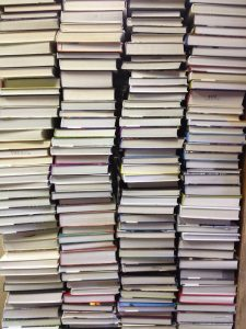 Image of a tall stack of books